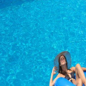 Woman enjoying the swimming pool