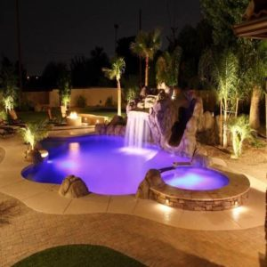 A pool with beautiful violet light at night