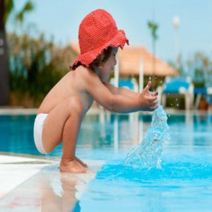 child playing near pool